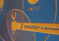 "illustration of a hand holding a tool. Words ""Strategy"" and ""Info"" are printed."