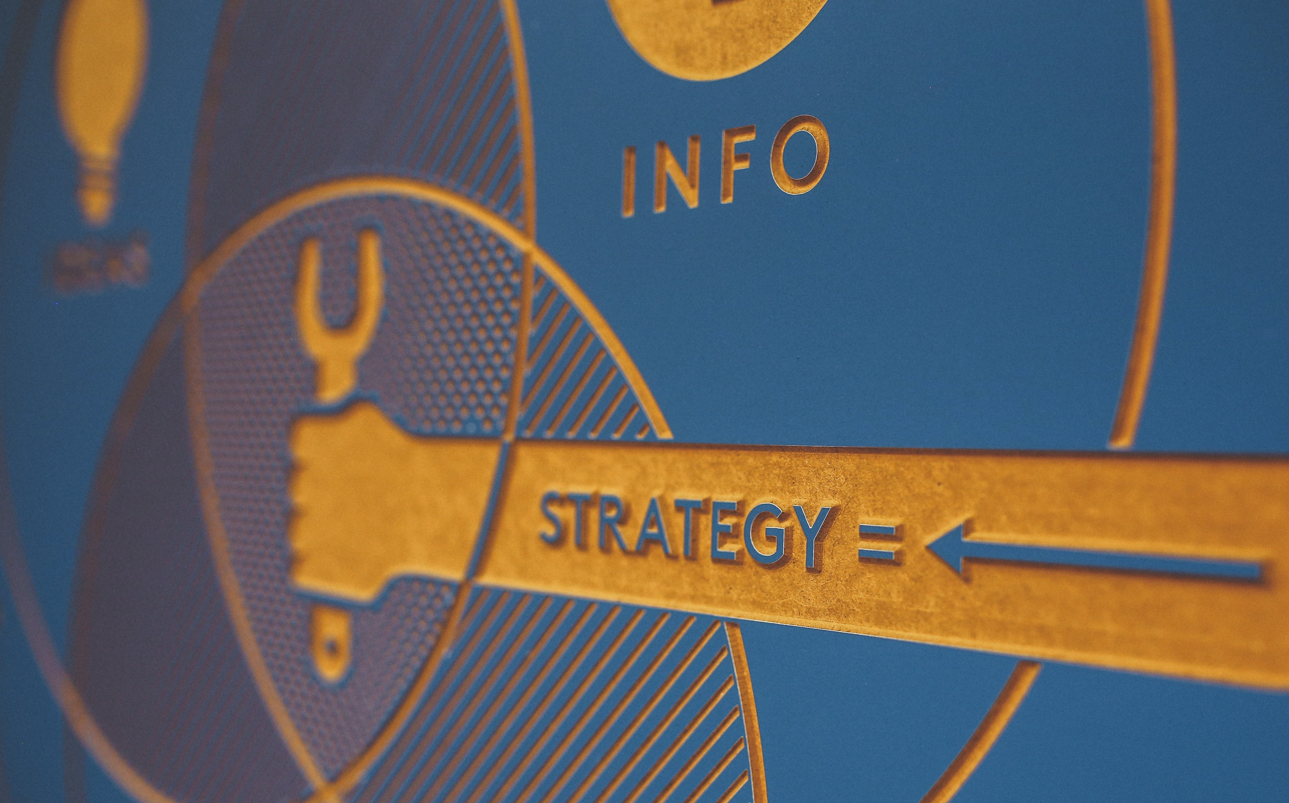 "illustration of a hand holding a tool. Words ""Strategy"" and ""Info"" are printed to indicate the importance of content marketing strategy."